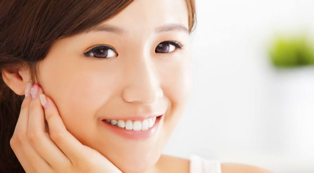 collagen for teeth asian smiling