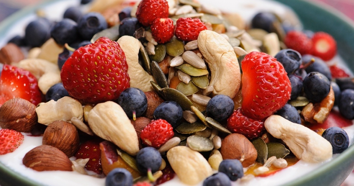 Bowl of yogurt with nuts and fresh berries